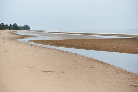 Scene of Pranburi beach in cloidy day