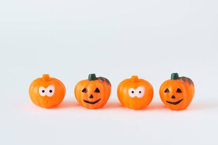 Four pumpkins on white background. Happy halloween.