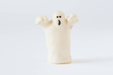 Happy Halloween. A white funny ghost on white bckground 写真素材
