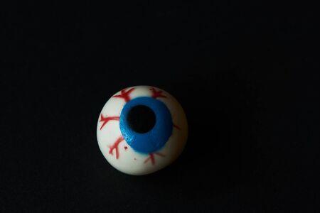 A halloween eyeball on black background