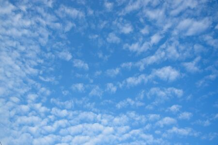 Background of beautiful stratocumulus clouds on blue sky in the morning