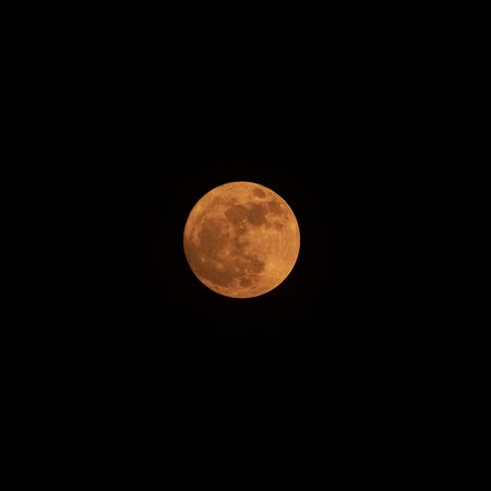 View of beautiful yellow color full moon with detailed craters in the dark Stok Fotoğraf