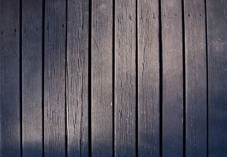 Pattern of old vertical wooden background and sunlight