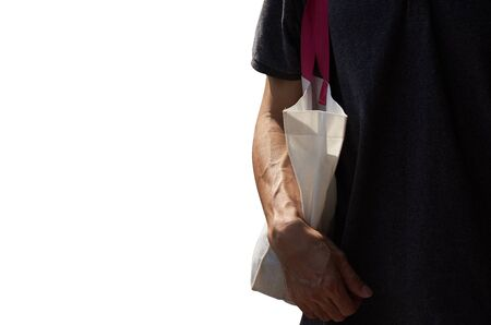No more plastic. An asian man carrying cloth bag for shopping in the city isolated on white