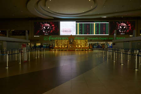 Bangkok, Thailand-April 29, 2020: Quiet airport and no tourists and passengers in the airport because of shut down from coronavirus pandemic outbreak.