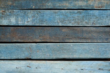 Background of old blue vintage wood with knot and nail holes
