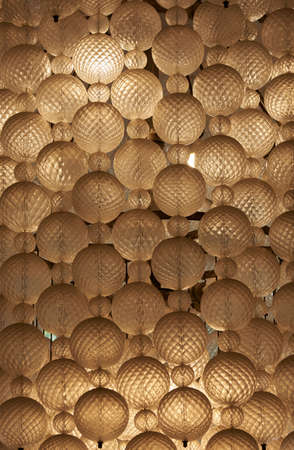 Background pattern of illuminated hanging sphere lamps