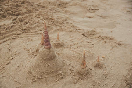 Close-up view of  Buddhist temples made form sand on the beach. Using seashells to be towers. Stockfoto