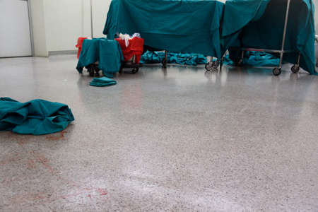 Dirty and blood stained operating room floor after surgery
