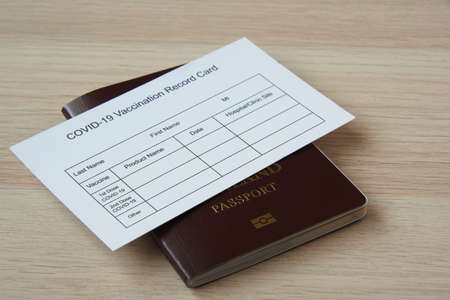 Passport and immunization record card for travel after  covid-19 vaccination