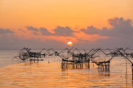 Sunrise and beautiful orange sky , giant square dipnets for trapping fish
