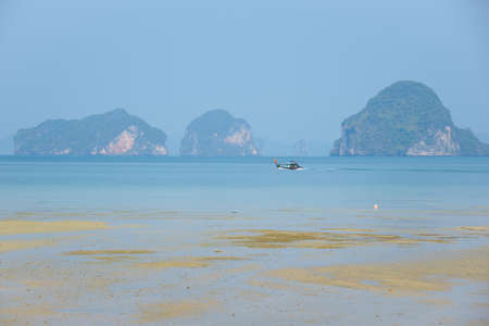 Krabi, Thailand-March 19, 2021:A tourist boat with passengers travelling on the sea at Tubbkaak beach, Krabi province, Thailand. Sajtókép