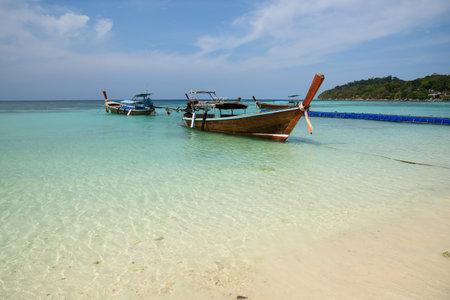 Scene of beautiful Pattaya beach and longtail boats at Lipe island, Satun province, Thailand.