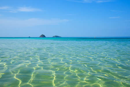 Beautiful clear turquoise sea and waves with blue sky background at Koh Yang, Satun province, Thailand. Stock fotó