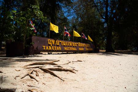 Satun, Thailand-March 15, 2021: Tarutao national park sign on the beach.