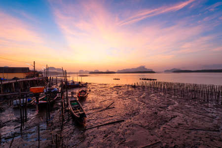Beautiful sky in the morning during sunrise and fisherman longtail boats Stock fotó