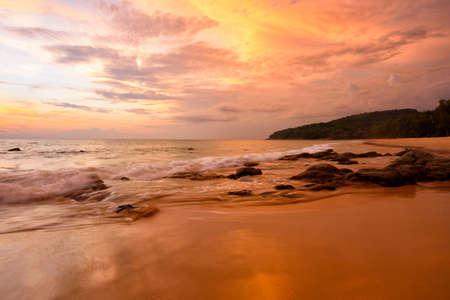 Scene of beautiful sunset sky and seawave at Naithon beach, Phuket Stock fotó