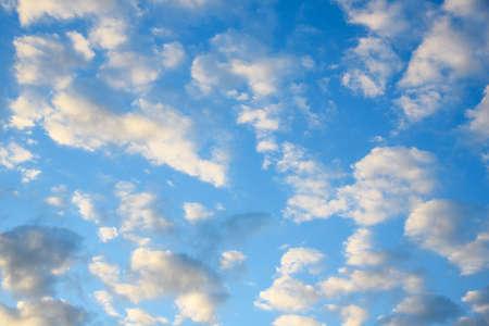 Cumulus clouds on blue sky background