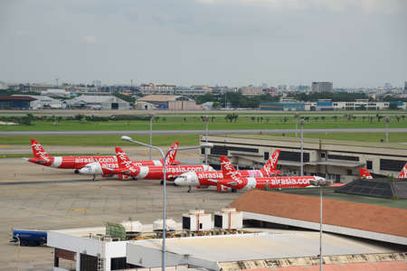 Bangkok, Thailand-August 2, 2021: Many Air Asia airline planes stopping travel flight at Don Muang international airport during covid-19 delta variant pandemic.