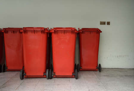 Red garbage bins for infectious waste placed indoor in hospital