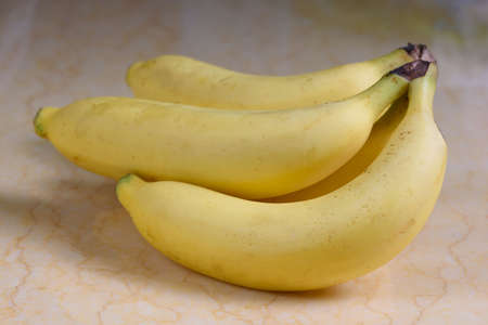 A bunch of yellow banana on the table