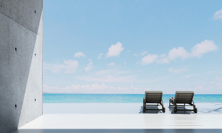 The luxury lounge beach deck and living room inteior design and sea view Standard-Bild
