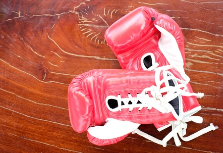 Boxing gloves on wooden table. Stock Photo