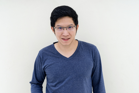 Smiling young asian man with long sleeve T-Shirt and glasses.