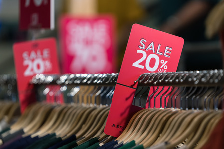 20% sale off red and white sign. Discount sale banner at cloth bar store. Foto de archivo