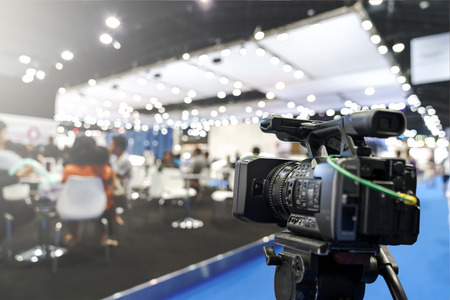 Behind the film shooting video,movie on digital camera. Taking photo,cinema broadcast television,show production maker of events, convention or exhibition. Expo news with footage equipment concept. Stock Photo