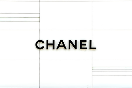 BANGKOK,THAILAND - APRIL 26th,2018: CHANEL logo on the white wall in front of Chanel boutique store at the Emquartier store. Chanel is a most social luxury brand in the world.