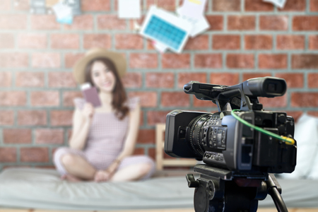 Behind the film shooting video,movie,vlog digital camera. Young beautiful asian woman taking photo,cinema broadcast television,show production maker. Entertainment news with footage equipment concept. Stock Photo
