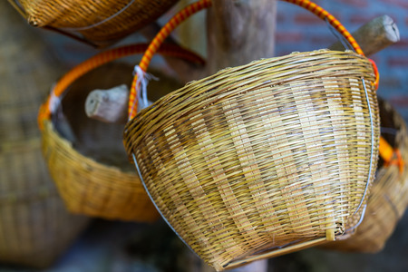 Bamboo wicker basket with top view from antique asian store hanging for sale. Texture and Pattern from traditional bamboo materials. Rural handicraft with beautiful craft culture.