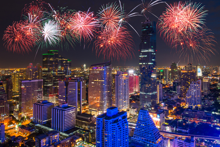 Bangkok Cityscape in Business district and high building at night with celebration fireworks.