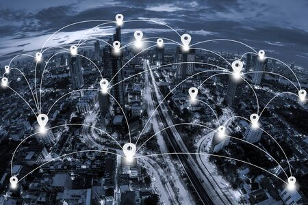 conection: Map pin flat and Network business conection system on blue tone Aerial view of cityscape Bangkok business district at twilight  background. Stock Photo