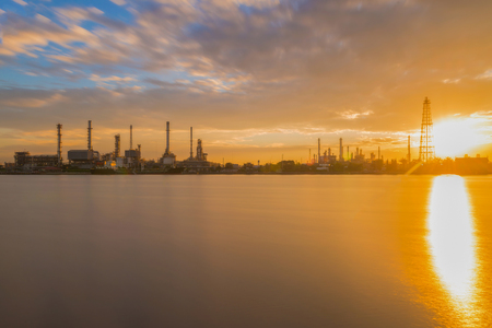 downstream: Oil refinery or petroleum refinery industrial process plant with sunrise, oil refineries use much of the technology, as types of chemical plants, the downstream side of the petroleum industry.