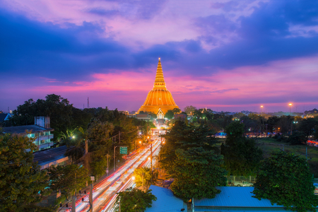 Aerial view of Large golden pagoda in Thailand at sunset, Located in the community at sunset , Phra Pathom Chedi , Nakhon Pathom , Thailand.