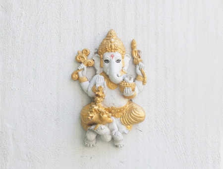 Small  Ganesha  on a white wall