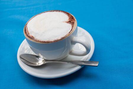 cappucino: Hot Cappucino coffee on blue background