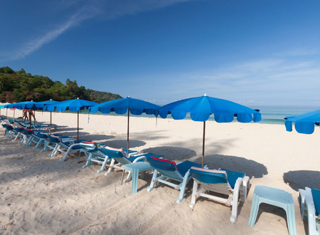 blue romance: Chairs and umbrella on a beautiful tropical beach