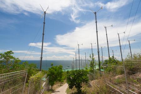 regenerating: Wind turbines and blue sea. Stock Photo
