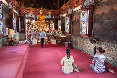 temple thailand: Thai woman praying in the  temple , Thailand Stock Photo