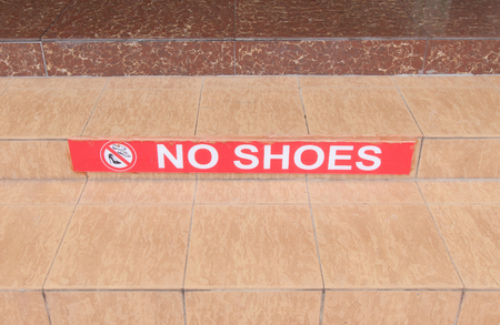 Symbol of no shoes on stair.