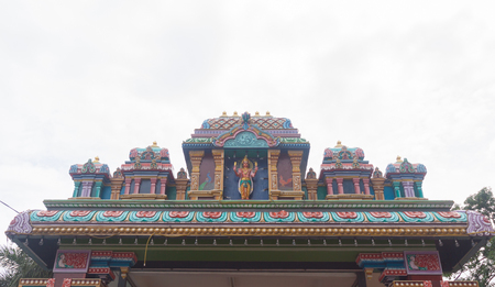 Details of the decorations on the roof of the  Hindu temple on white background.