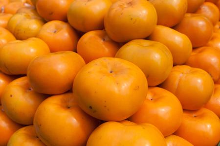Persimmon sweet summer fruit faw fresh food.