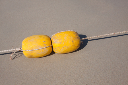 Yellow buoy in the beach.