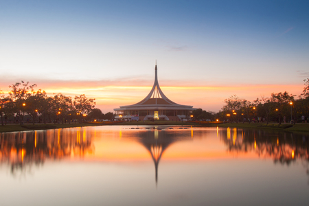 repose: Monument in public park of thailand. Twilight shooting reflection on water concept at the Suanluang Rama 9, Thailand Stock Photo