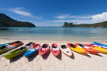 Colorful kayaks on the beach.