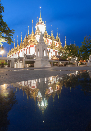 Famous temple at Night: Loha prasat (metallic castle) of Ratchanadda Temple in Bangkok, Thailand
