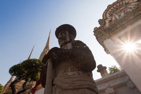 Gian at buddhist temple with flare at Bangkok,Thailand